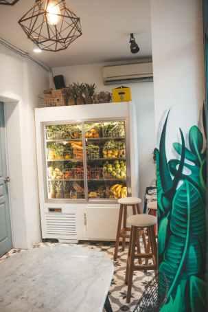 white refrigerator near door